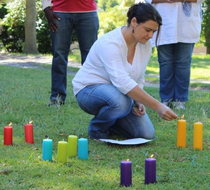 Juanita leading a candle prayer at FLEAT workshop -  web -copy