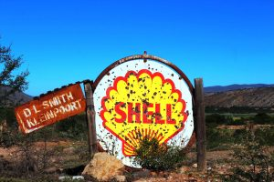 A rusty sign points to a now defunct Shell petrol station in the Karoo CStefan Cramer