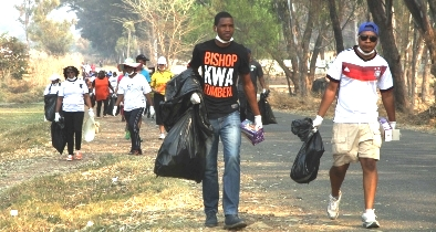 Sean Innoscent  Ukomba of  Climate Impact Faith Alliance in an adopt a  neighbourhood clean-up