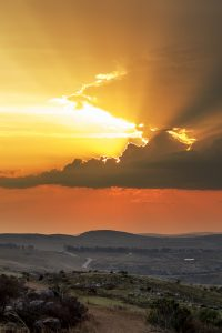 The sun sets over Grahamstown as a storm blows in from the horizn, as seen from the Toposcope, Sunday 17 August 2014. (Louisa Feiter)